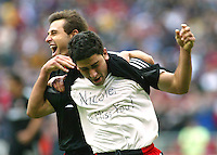 3 April 2004: DC United Dema Kovalenko celebrates with Alecko Eskandarian after Alecko scored a goal in first half of the game against Earthquakes at RFK Stadium in Washington D.C..  Credit: Michael Pimentel / ISI