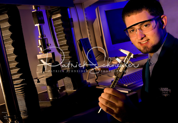 A male worker uses a tool to measure plastics at Polymers Center of Excellence in Charlotte. The Polymers Center of Excellence provides state-of-the-art plastics product design, engineering, and analysis services to the medical, transportation, materials handling, packaging, and consumer products industries.