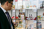 A visitor looks at Japanese products on display the 42nd International Food and Beverage Exhibition (FOODEX JAPAN 2017) in Makuhari Messe International Convention Complex on March 8, 2017, Chiba, Japan. About 3,282 companies from 77 nations are participating in the Asia's largest food and beverage trade show. This year organizers expect 77,000 visitors for the four-day event, which runs until March 10. (Photo by Rodrigo Reyes Marin/AFLO)