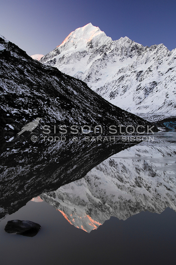 Mount Cook / Aoraki reflected in  Hooker Lake at sunset. Portrait / Vertical