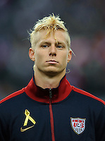 Brek Shea of team USA stands for the national anthem prior to the friendly match France against USA at the Stade de France in Paris, France on November 11th, 2011.