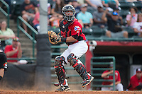 Hickory Crawdads catcher Jose Trevino (7) checks the runner at first base after having tagged a runner out at home plate during the game against the West Virginia Power at L.P. Frans Stadium on August 15, 2015 in Hickory, North Carolina.  The Power defeated the Crawdads 9-0.  (Brian Westerholt/Four Seam Images)