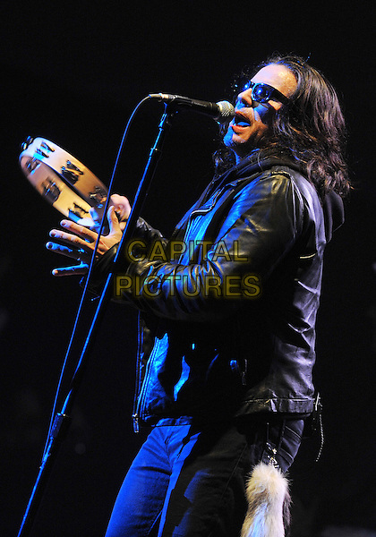 """Lead vocalist IAN ASTBURY of the legendary British rock band THE CULT perform at a stop on their 2012 U.S. Tour to support their new album """"Choice of Weapon"""" held at the Stage AE, Pittsburgh, PA., USA..3rd June 2012 .on stage in concert live gig performance music half length black leather jacket sunglasses shades singing side profile tambourine .CAP/ADM/DS.©Devin Simmons/AdMedia/Capital Pictures."""
