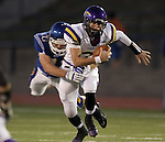SIOUX FALLS, SD - OCTOBER 11:  Logan Gabriel #2 From Watertown is brought down by Isaac Althoff #42 from O'Gorman in the first quarter of their game Friday night at O'Gorman.  (Photo by Dave Eggen/Inertia)
