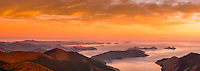 Sunrise over Cook Strait seen from highest peak in Marlborough Sounds, Mt. Stokes 1203m. D'Urville Island visible on horizon very left. Anakoha Bay at bottom right, Nelson Region, Marlborough, New Zealand
