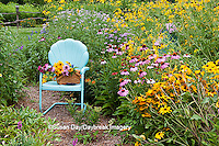 63821-205.18  Garden path with  blue chair, basket, and birdhouses.   Black-eyed Susans (Rudbeckia hirta), Purple Coneflowers (Echinacea purpurea), Gray-headed Coneflowers (Ratibida pinnata) and Pink Bee balm (Monarda fistulosa), Marion Co. IL