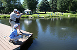Breast cancer survivor Jinnie Ziemer works to reel in her catch with guide Kurt Zeilenga during a Casting for Recovery retreat in Gardnerville, Nev., on Friday, June 30, 2017. <br /> Photo by Cathleen Allison/Nevada Photo Source