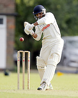 Sikander Randhawa bats for Harrow during the Middlesex County Cricket League Division Two game between Harrow St Mary's and Shepherds Bush at<br /> Harrow on Sat July 19, 2014