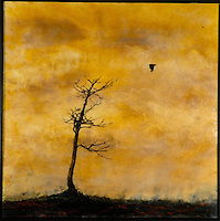 Mixed media encaustic photo painting of bare tree with crow in yellow ochre sky.