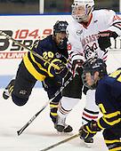 Ryan Flanigan (Merrimack - 20), Mike Hewkin (Northeastern - 28) - The visiting Merrimack College Warriors defeated the Northeastern University Huskies 4-3 (OT) on Friday, February 4, 2011, at Matthews Arena in Boston, Massachusetts.