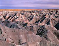 67SDBD_102 - USA, South Dakota, Badlands National Park, North Unit, Expansive area of soft, eroded clay formations and distant grassy plains, view east from Big Badlands Overlook.