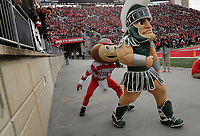 Brutus Buckeye sneaks up on Michigan State mascot Sparty during the third quarter of the NCAA football game against the Michigan State Spartans at Ohio Stadium in Columbus on Nov. 11, 2017. [Adam Cairns/Dispatch]