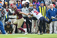 Landover, MD - November 18, 2018: Washington Redskins wide receiver Trey Quinn (14) is pushed out of bounds by Houston Texans free safety Tyrann Mathieu (32) during the  game between Houston Texans and Washington Redskins at FedEx Field in Landover, MD.   (Photo by Elliott Brown/Media Images International)