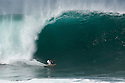Dereck Ho doing a huge bottom turn at Pipeline on the North Shore in Hawaii