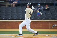 DJ Poteet (4) of the Wake Forest Demon Deacons follows through on his swing against the Notre Dame Fighting Irish at David F. Couch Ballpark on March 10, 2019 in  Winston-Salem, North Carolina. The Demon Deacons defeated the Fighting Irish 7-4 in game one of a double-header.  (Brian Westerholt/Four Seam Images)