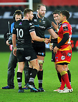 Gavin Henson of the Dragons (R) speaks with Dan Biggar, Alun Wyn Jones and James Hook and Sam Davies of the Ospreys (R) during the Guinness PRO14 match between Ospreys and Dragons at The Liberty Stadium, Swansea, Wales, UK. Friday 27 October 2017