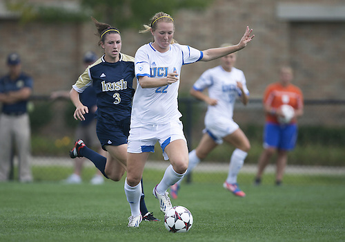 September 01, 2013:  UCLA midfielder Samantha Mewis (22) advances the ball as Notre Dame midfielder Morgan Andrews (3) defends during NCAA Soccer match between the Notre Dame Fighting Irish and the UCLA Bruins at Alumni Stadium in South Bend, Indiana.  UCLA defeated Notre Dame 1-0.