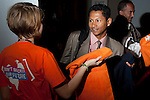 A member of the Intenrational Youth Climate Movement hands out a scarf to a delegate to signify the beginning of Youth and Future Generations Day. (Images free for Editorial Web usage for Fresh Air Participants during COP 15. Credit: Robert vanWaarden)