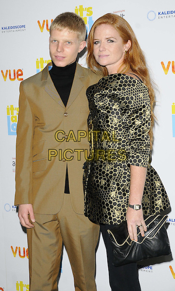 Charlie Palmer-Merkle &amp; Patsy Palmer<br /> The &quot;It's A Lot&quot; UK film premiere, Vue West End cinema, Leicester Square, London, England.<br /> October 21st, 2013<br /> half length black top beige brown suit pattern metallic jacket leggings clutch bag gold<br /> CAP/CAN<br /> &copy;Can Nguyen/Capital Pictures