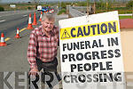 Signing Up: Danny Lyons, who has to use his own road signs to calm traffic outside his funeral home in Derry, Listowel, where traffic travels at speeds of up to 100 km-h..