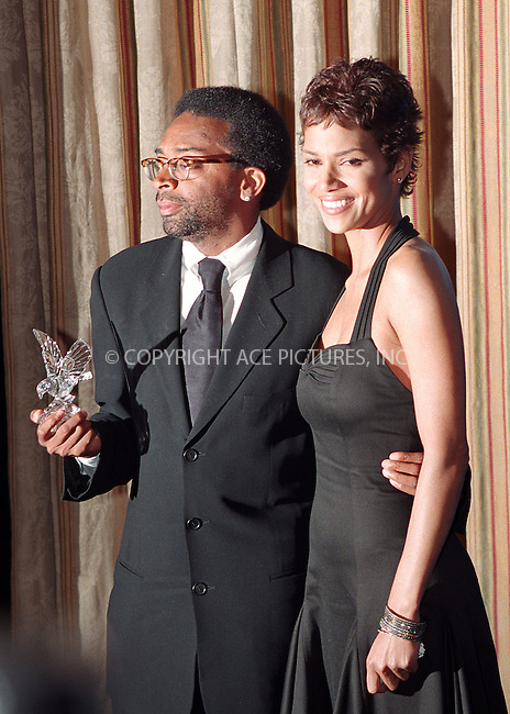Spike Lee and Halle Berry at the Directors Guild of America Honors 2002 at the Waldorf-Astoria in New York City. June 9, 2002. REF: AMUS2099. Please byline: Anthony Moore/NY Photo Press.   ..*PAY-PER-USE*      ....NY Photo Press:  ..phone (646) 267-6913;   ..e-mail: info@nyphotopress.com