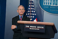 Director of the National Institute of Allergy and Infectious Diseases at the National Institutes of Health Dr. Anthony Fauci waits for President Donald Trump to deliver remarks on the COVID-19 (Coronavirus) pandemic alongside members of the Coronavirus Task Force in the Brady Press Briefing Room at the White House in Washington, DC, March 25, 2020, in Washington, D.C. <br /> Credit: Sarah Silbiger / Pool via CNP/AdMedia