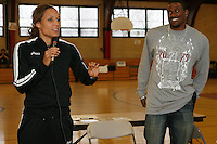 Lolo Jones speaking to the audience while David Oliver looks on at the Tobin Community Center in Roxbury,MA on Friday, February 22, 2008. Photo by Errol Anderson,The Sporting Image.