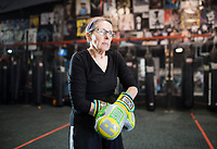 NWA Democrat-Gazette/CHARLIE KAIJO Jonelle Lipscomb practices puts on her boxing gloves during a boxing class geared towards people with Parkinson's disease, Monday, December 10, 2018 at Straightright Boxing and Fitness Springdale.