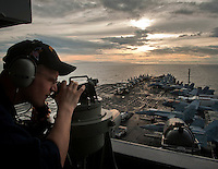 110528-N-DR144-298 SURIGAO STRAIT (May 28, 2011) Quartermaster Seaman Jacob Williams uses a telescopic alidade to establish the bearing of known reference points on islands in the Philippines as Nimitz-class aircraft carrier USS Carl Vinson (CVN 70) and ships assigned to Carrier Strike Group (CSG) 1 approach the Surigao Strait.  Carl Vinson and Carrier Air Wing (CVW) 17 are underway in the U.S. 7th Fleet area of responsibility. (U.S. Navy photo by Mass Communication Specialist 2nd Class James R. Evans / Released))