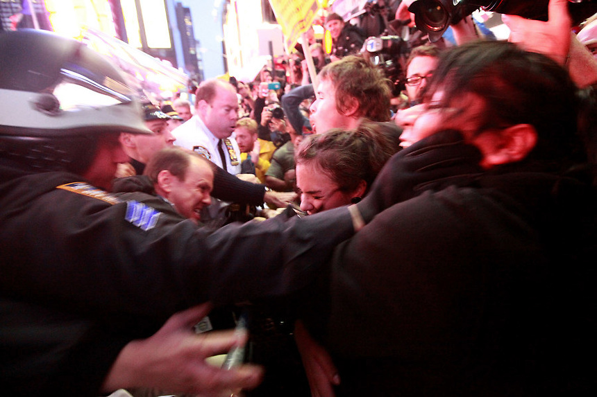 Occupy Wall Street protesters clash with police when they try to make their way into the intersection of W46st street and 7th Ave on Saturday, October 15, 2011.  As the protesters reached the corner of w46st street and 7th ave, approaching from the east, they were met by a wall of police officers.
