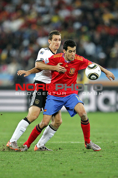 07.07.2010, Moses Mabhida Stadium, Durban, SOUTH AFRICA, Deutschland ( GER ) vs Spanien ( ESP ) im Bild Sergio Busquets of Spain and Miroslav Klose of Germany  Foto &copy;  nph /  Kokenge *** Local Caption *** Fotos sind ohne vorherigen schriftliche Zustimmung ausschliesslich f&uuml;r redaktionelle Publikationszwecke zu verwenden.<br /> <br /> Auf Anfrage in hoeherer Qualitaet/Aufloesung