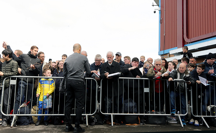 Manchester City manager Josep Guardiola signs autographs for the waiting fans as he arrives ahead of kick-off at Turf Moor<br /> <br /> Photographer Rich Linley/CameraSport<br /> <br /> The Premier League - Burnley v Manchester City - Sunday 28th April 2019 - Turf Moor - Burnley<br /> <br /> World Copyright © 2019 CameraSport. All rights reserved. 43 Linden Ave. Countesthorpe. Leicester. England. LE8 5PG - Tel: +44 (0) 116 277 4147 - admin@camerasport.com - www.camerasport.com
