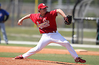 St. Louis Cardinals minor league pitcher Jesse Simpson #25 delivers a pitch during a spring training game vs the New York Mets at the Roger Dean Sports Complex in Jupiter, Florida;  March 24, 2011.  Photo By Mike Janes/Four Seam Images