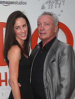 LOS ANGELES, CA - JULY 11: Charlotte Taschen, Udo Kier, at the premier of Don't Worry, He Won't Get Far On Foot on July 11, 2018 at The Arclight Hollywood in Los Angeles, California. Credit: Faye Sadou/MediaPunch