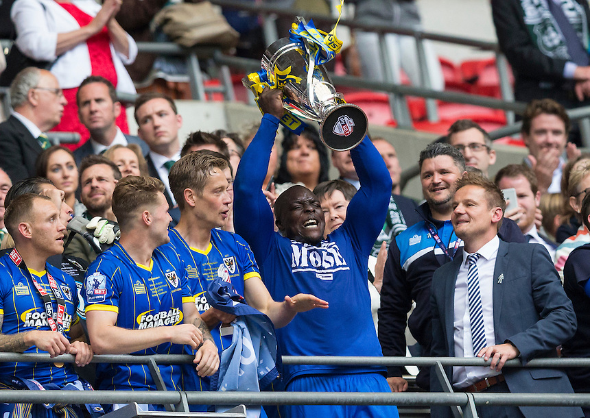 AFC Wimbledon's Adebayo Akinfenwa lifts the winner's trophy<br /> <br /> Photographer Craig Mercer/CameraSport<br /> <br /> Football - The Football League Sky Bet League Two Play-Off Final - AFC Wimbledon v Plymouth Argyle - Monday 30 May 2016 - Wembley Stadium - London<br /> <br /> World Copyright &copy; 2016 CameraSport. All rights reserved. 43 Linden Ave. Countesthorpe. Leicester. England. LE8 5PG - Tel: +44 (0) 116 277 4147 - admin@camerasport.com - www.camerasport.com