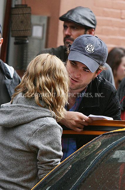 WWW.ACEPIXS.COM ************....June 24 2009, New York City....Actors Robert Pattinson and Emilie de Ravin on theSoho set of the new movie 'Remember me' on June 24 2009 in New York City....Please byline: PHILIP VAUGHAN - ACEPIXS.COM.. *** ***  ..Ace Pictures, Inc:  ..tel: (646) 769 0430..e-mail: info@acepixs.com..web: http://www.acepixs.com