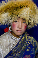 Nomad girl wearing fur hat in the Damda region, Kham, Tibet.<br />