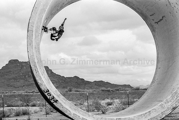 Tony Alva skateboards in the California desert. 1978. Photo by John G. Zimmerman