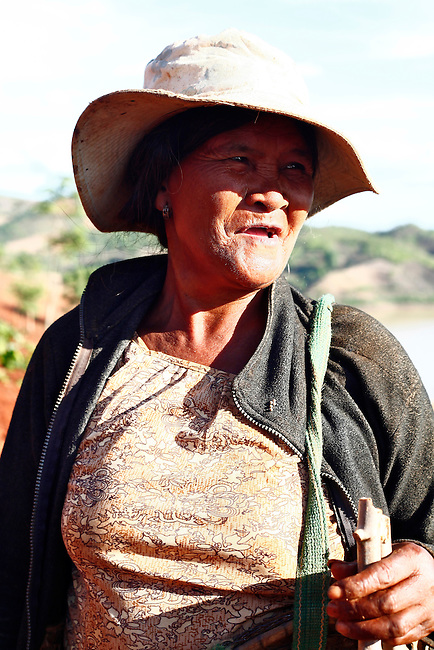 A Jarai woman takes a break from planting cassava while working in a field in the hills near the Central Highlands town of Kon Tom, Vietnam. The Jarai are the largest of more than two dozen tribes known formerly in the West as Montagnards, but who are now called the Dega. April 14, 2012.