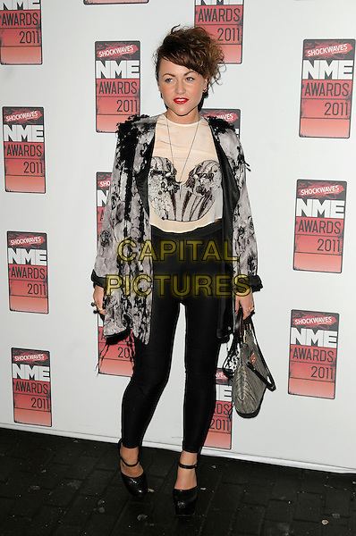 JAMIE WINSTONE .At the Shockwaves NME Awards 2011, O2 Academy Brixton, London, England, UK, 23rd February 2011..full length black leggings grey gray jacket top beige cream shoes bag mary janes flowers lace applique ruffles ruffle .CAP/CAN.©Can Nguyen/Capital Pictures.