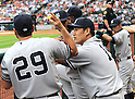 (L-R) Francisco Cervelli, Ivan Nova, Masahiro Tanaka, Ichiro Suzuki (Yankees),<br /> APRIL 1, 2014 - MLB :<br /> Masahiro Tanaka of the New York Yankees talks with his teammate Francisco Cervelli in the dugout during the baseball game against the Houston Astros at Minute Maid Park in Houston, Texas, United States. (Photo by AFLO)
