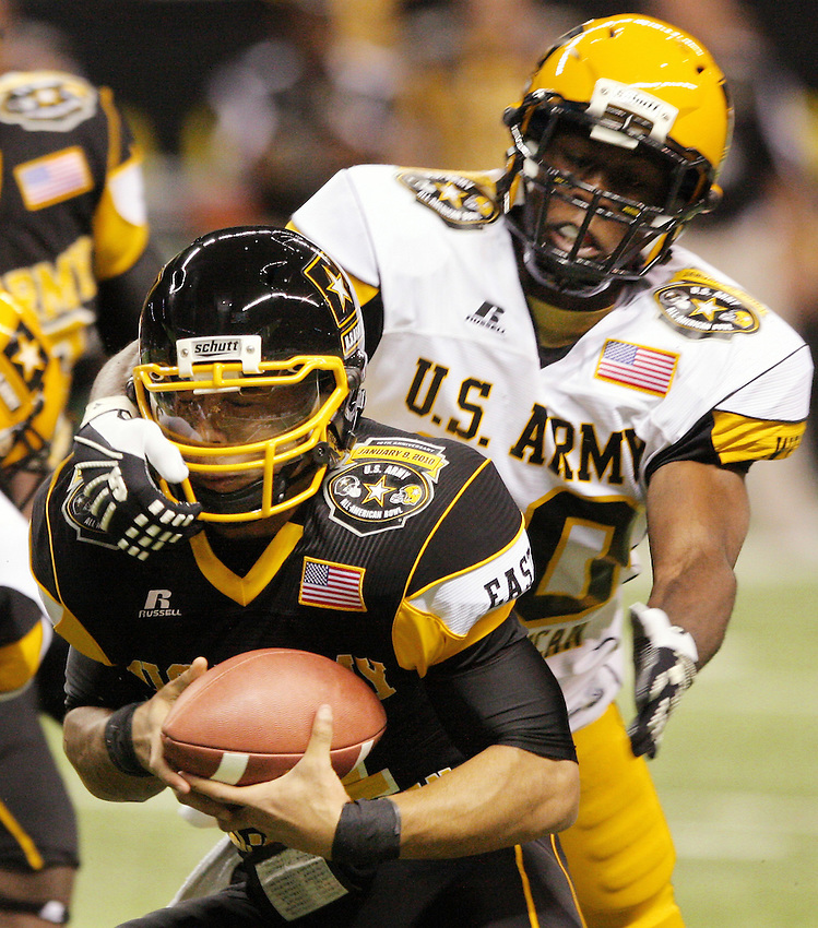East's Barry Brunetti, left, is brought down by West's Jarrick Williams during the first half of the U.S. Army All-American Bowl, Saturday, Jan. 9, 2010, at the Alamodome in San Antonio. (Darren Abate/pressphotointl.com)