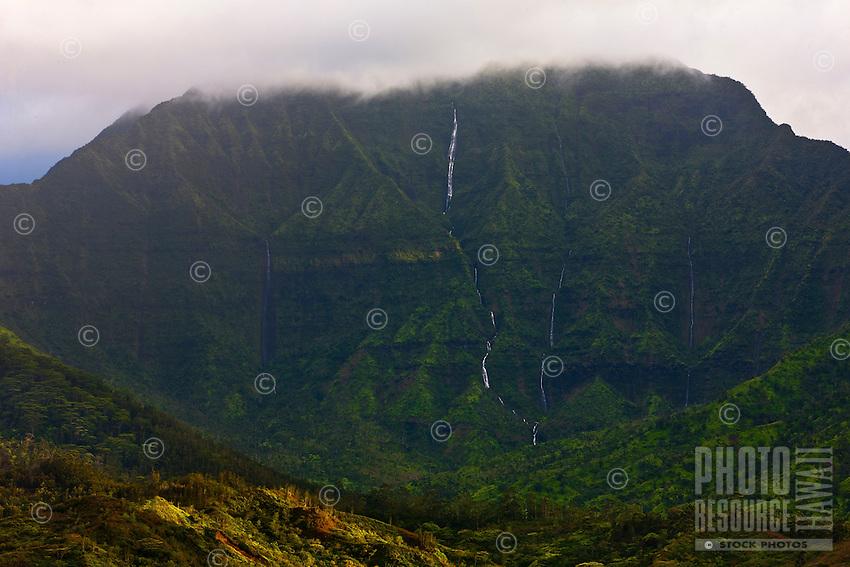 Namolokama stands proud over Hanalei, Kauai, as its waterfalls pour down the mountain toward the sea.