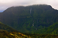 Namolokama stands proud over Hanalei, Kauai, as its waterfalls pour down the mountain toward the sea.