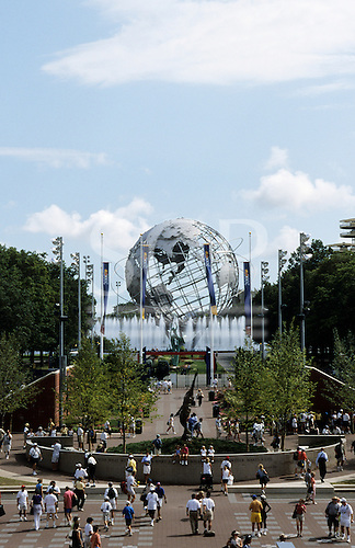 Flushing Meadows, New York, USA. 'The Athlete' statue with 1964 Worlds Fair Unisphere behind.