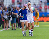 REIMS,  - JUNE 24: Megan Rapinoe #15 talks to Allie Long #20 during a game between NT v Spain and  at Stade Auguste Delaune on June 24, 2019 in Reims, France.