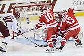 Jimmy Hayes (BC - 10) is stopped by Corey Trivino (BU - 10) and Garrett Noonan (BU - 13). - The Boston College Eagles defeated the visiting Boston University Terriers 5-2 on Saturday, December 4, 2010, at Conte Forum in Chestnut Hill, Massachusetts.