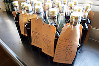 Small sample bottles of wine with samples taken that will be sent in to the control authority INAVI - the National wine institute. Vinedos y Bodega Filgueira Winery, Cuchilla Verde, Canelones, Montevideo, Uruguay, South America