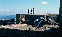 Tourists walk through the ruins of the Citadelle Henri Christophe near Cap-Haïtien, Haiti, 1981.  (Photo by Brian Cleary/www.bcpix.com)