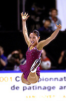 Skater MICHELLE KWAN perform split leap on way to winning gold in Ladies at 2001 World Championships at Nice, France in March, 2001..(Photo by Tom Theobald).